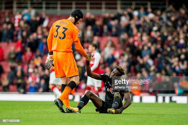 Tammy Abraham of Swansea City is helped up by Petr Cech of Arsenal after the final whistle of the Premier League match between Arsenal and Swansea...