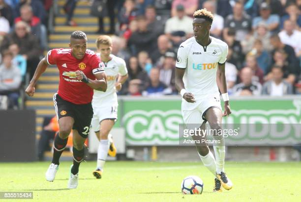 Tammy Abraham of Swansea City is marked by Antonio Valencia of Manchester United during the Premier League match between Swansea City and Manchester...
