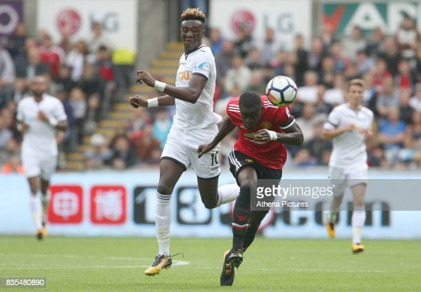 Tammy Abraham of Swansea City is marked by Eric Bailly of Manchester United during the Premier League match between Swansea City and Manchester...