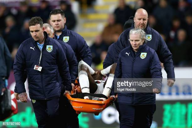 Tammy Abraham of Swansea City is stretchered off during the Premier League match between Burnley and Swansea City at Turf Moor on November 18 2017 in...