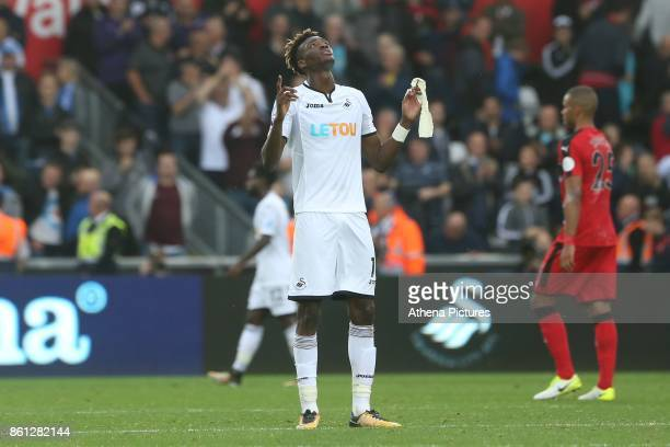Tammy Abraham of Swansea City points the sky as he celebrates Swanseas win after the final whistle of the Premier League match between Swansea City...