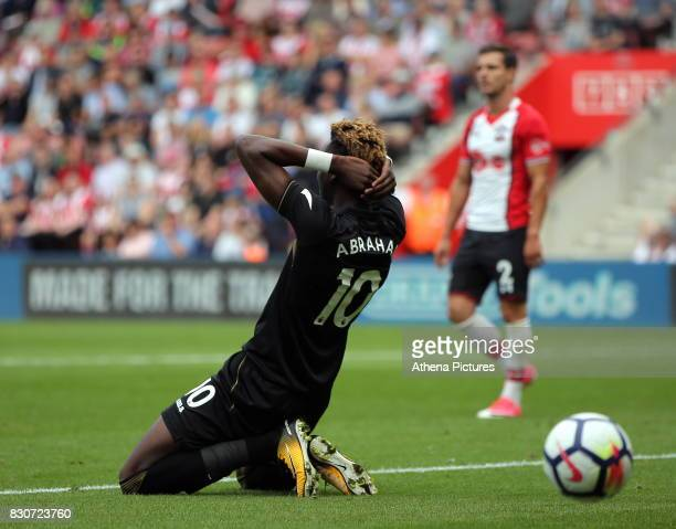 Tammy Abraham of Swansea City sits dejected on the ground after heading the ball wide during the Premier League match between Southampton and Swansea...