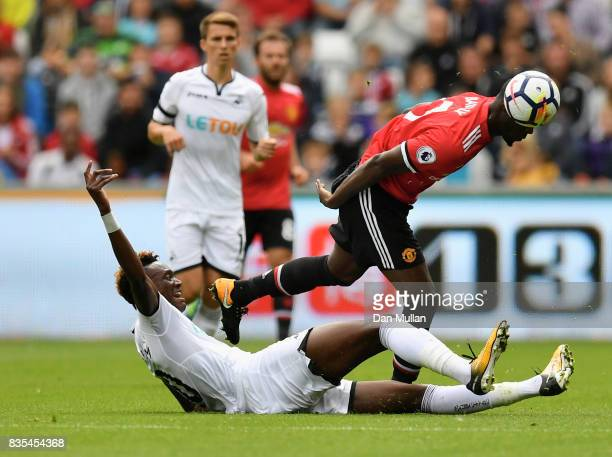 Tammy Abrahm of Swansea City and Eric Bailly of Manchester United battle for possession during the Premier League match between Swansea City and...