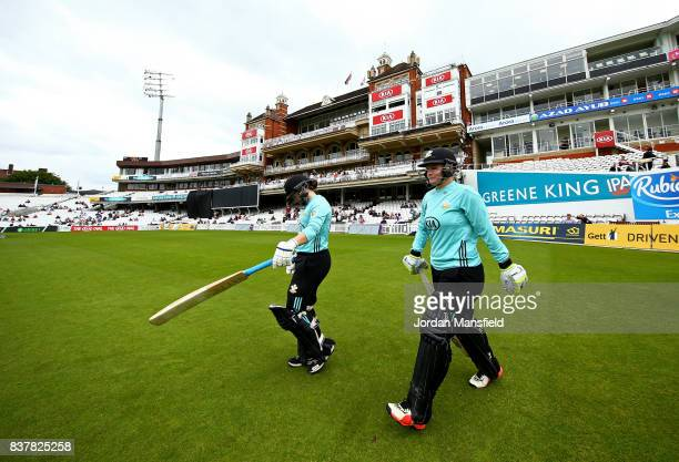 Tammy Beaumont and Lizelle Lee of Surrey make their way out to bat during the Kia Super League match between Surrey Stars and Western Storm at The...