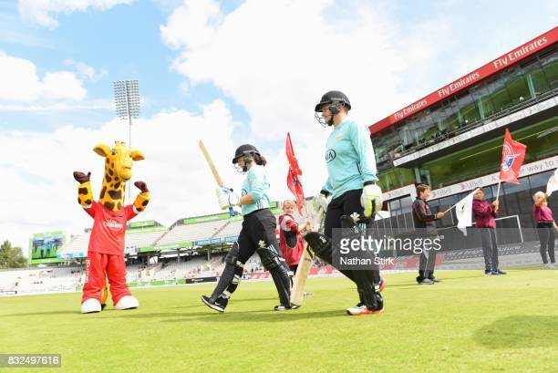 Tammy Beaumont and Lizelle Lee of Surrey Stars walk out to bat during the Kia Super League 2017 match between Lancashire Thunder and Surrey Stars at...