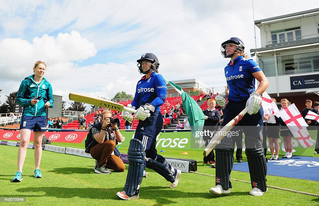 <a gi-track='captionPersonalityLinkClicked' href=/galleries/search?phrase=Tammy+Beaumont&family=editorial&specificpeople=6872444 ng-click='$event.stopPropagation()'>Tammy Beaumont</a> of England (L) and <a gi-track='captionPersonalityLinkClicked' href=/galleries/search?phrase=Lauren+Winfield&family=editorial&specificpeople=11087811 ng-click='$event.stopPropagation()'>Lauren Winfield</a> of England walk out to bat during the 3rd Royal Royal London ODI between England Women and Pakistan Women at The Cooper Associates County Ground on June 27, 2016 in Somerset, United Kingdom.