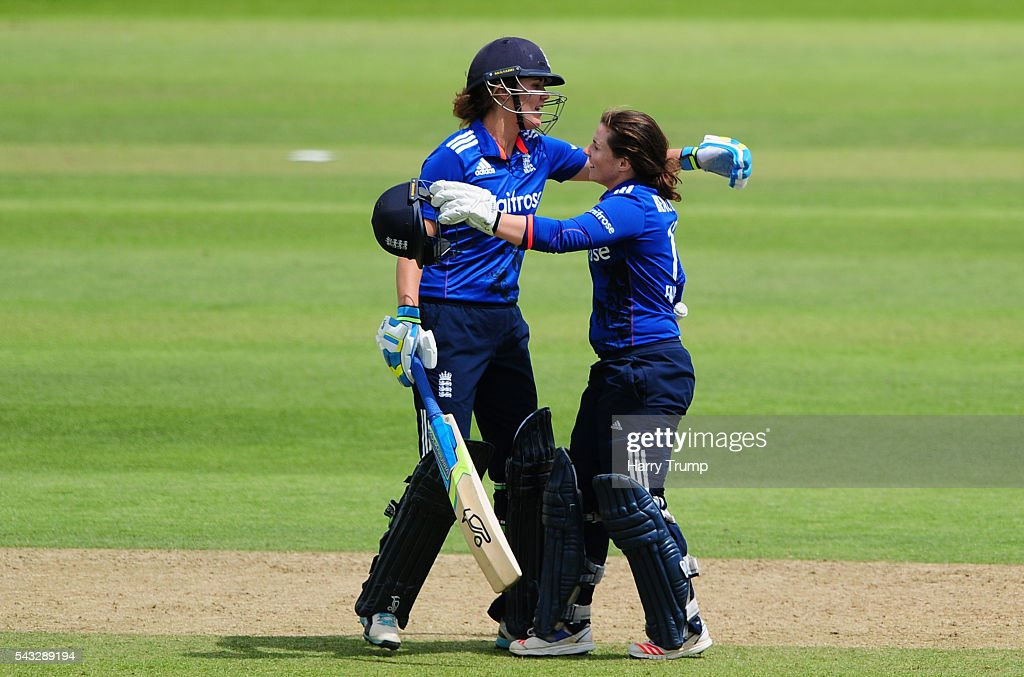 <a gi-track='captionPersonalityLinkClicked' href=/galleries/search?phrase=Tammy+Beaumont&family=editorial&specificpeople=6872444 ng-click='$event.stopPropagation()'>Tammy Beaumont</a> of England (R) celebrates her century during the 3rd Royal Royal London ODI between England Women and Pakistan Women at The Cooper Associates County Ground on June 27, 2016 in Somerset, United Kingdom.