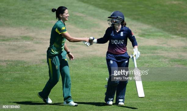Tammy Beaumont of England shakes hands with Marizanne Kapp of South Africa as she walks off after being dismissed for 148 during the ICC Women's...