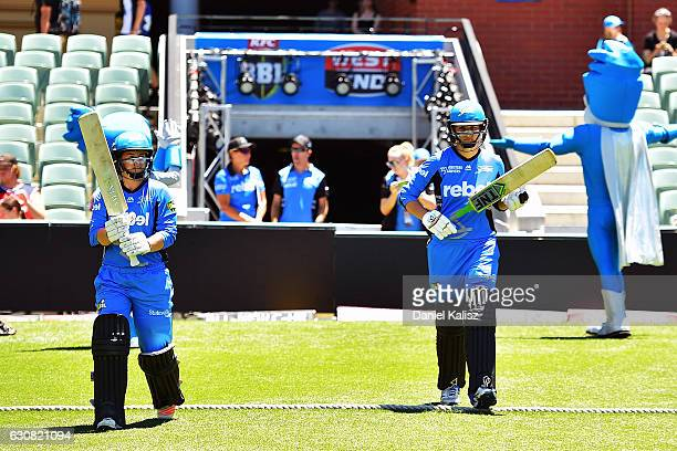Tammy Beaumont of the Adelaide Strikers and Alex Price of the Adelaide Strikers walk onto the field to bat during the WBBL match between the Strikers...