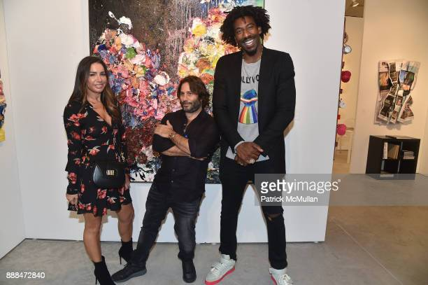Tammy Brook Mike Heller and Amar'e Stoudemire attend Art Miami VIP Preview at Art Miami Pavilion on December 6 2017 in Miami Beach Florida