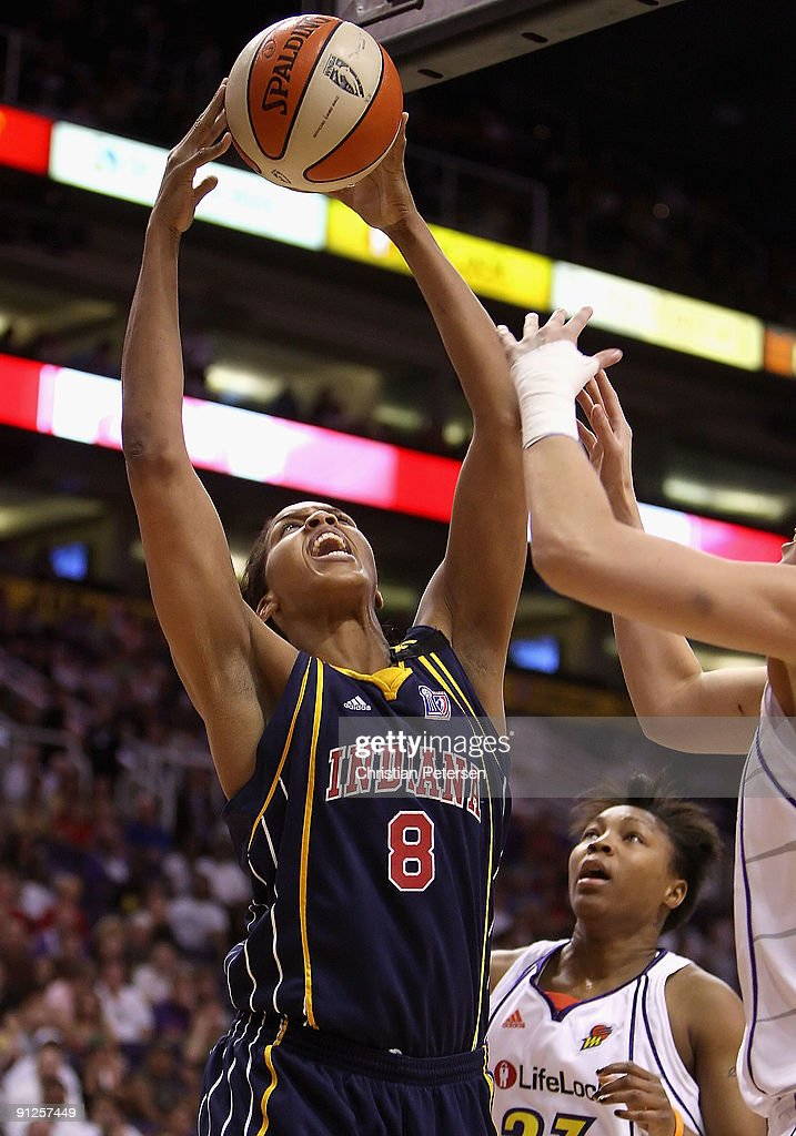 <a gi-track='captionPersonalityLinkClicked' href=/galleries/search?phrase=Tammy+Sutton-Brown&family=editorial&specificpeople=208212 ng-click='$event.stopPropagation()'>Tammy Sutton-Brown</a> #8 of the Indiana Fever grabs a rebound against the Phoenix Mercury in Game One of the 2009 WNBA Finals at US Airways Center on August 29, 2009 in Phoenix, Arizona.