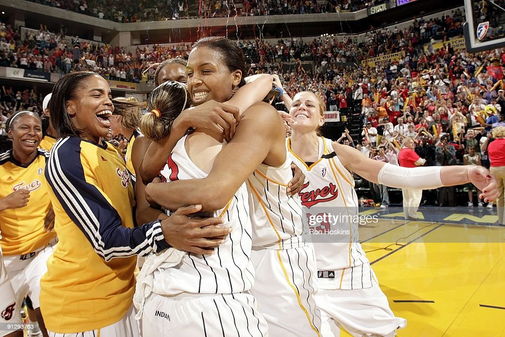 <a gi-track='captionPersonalityLinkClicked' href=/galleries/search?phrase=Tammy+Sutton-Brown&family=editorial&specificpeople=208212 ng-click='$event.stopPropagation()'>Tammy Sutton-Brown</a> #8 of the Indiana Fever hughs teammate <a gi-track='captionPersonalityLinkClicked' href=/galleries/search?phrase=Tully+Bevilaqua&family=editorial&specificpeople=211616 ng-click='$event.stopPropagation()'>Tully Bevilaqua</a> as they celebrate winning the Eastern Conference Championship after defeating the Detroit Shock in Game Three of the Eastern Conference Finals during the 2009 WNBA Playoffs at Conseco Fieldhouse on September 26, 2009 in Indianapolis, Indiana. The Fever won 72-67.