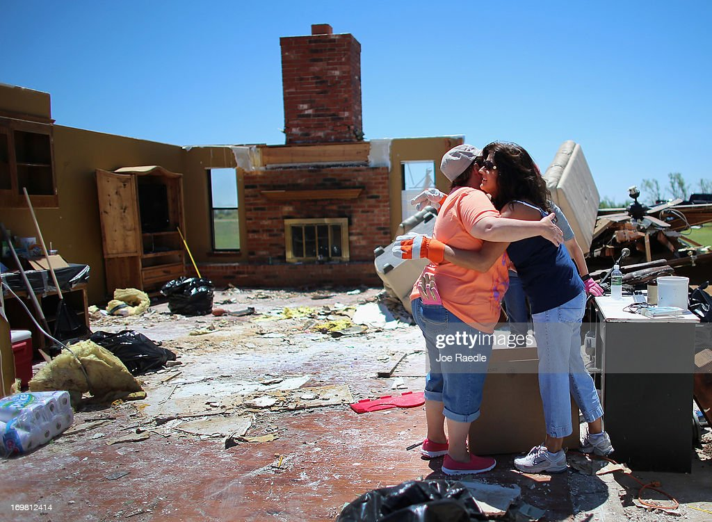 Tammy Wade (L) is hugged by Dana Givens in what is left of her home after it was destroyed by a tornado on June 2, 2013 in El Reno, Oklahoma. The tornado ripped through the area friday killing at least 9 people, injuring many and destroyed homes and buildings.