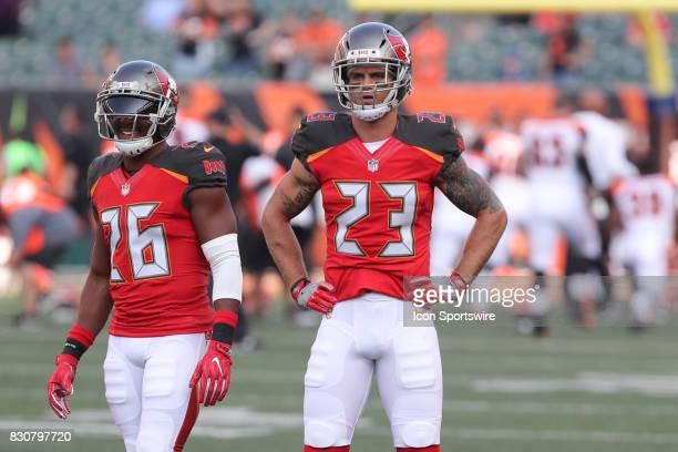 Tampa Bay Buccaneers defensive back Josh Robinson and Tampa Bay Buccaneers strong safety Chris Conte warm up before the preseason game against the...