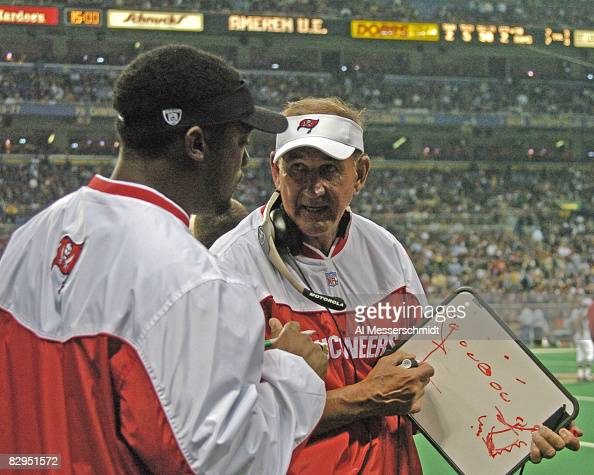Tampa Bay Buccaneers defensive coordinator Monte Kiffin checks play against the St Louis Rams October 18 2004 at the Edward Jones Dome in St Louis...