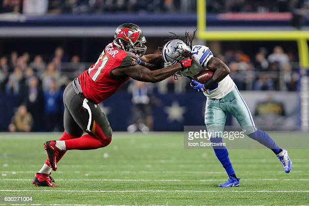 Robert Ayers Tennessee Volunteers Autographed 8 Tampa Bay Buccaneers  defensive end Robert Ayers tackles Dallas Cowboys wide receiver Lucky  Whitehead on an ... d8337de78