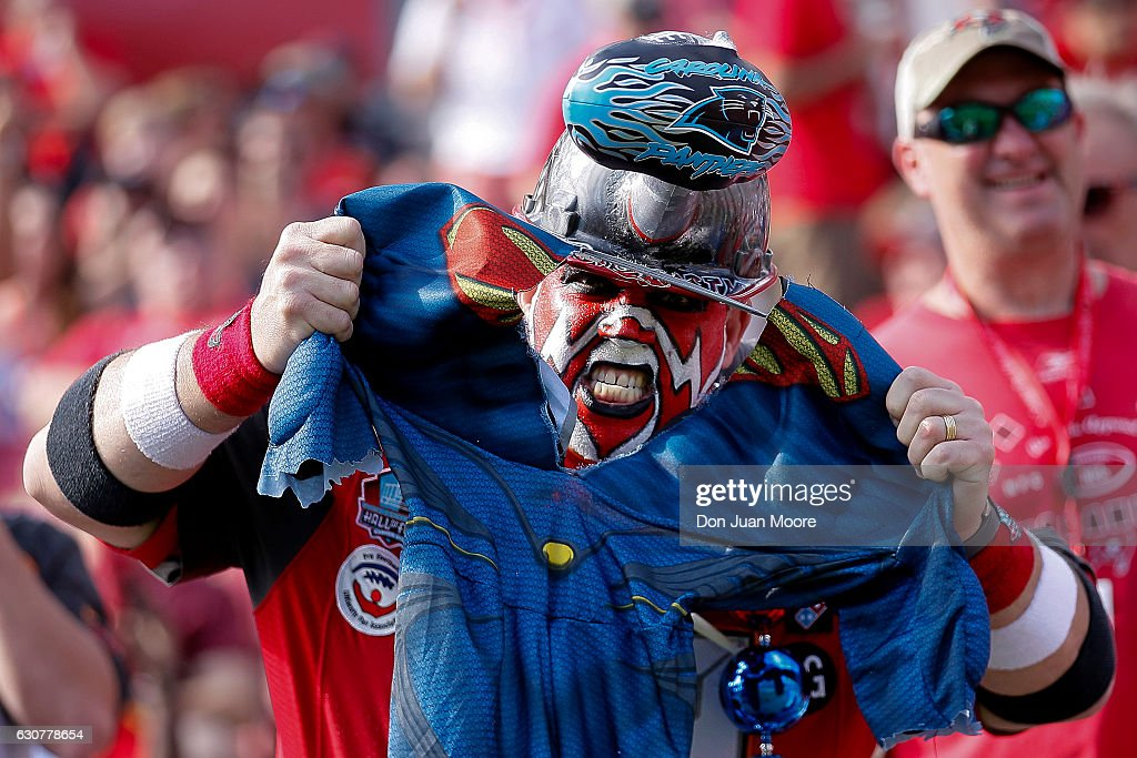 A Tampa Bay Buccaneers fan who calls himself 'Big Nasty' tears a Superman shirt during the game against the Carolina Panthers at Raymond James Stadium on January 1, 2017 in Tampa, Florida. The Buccaneers defeated the Panthers 17 to 16.