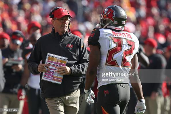 Tampa Bay Buccaneers head coach Dirk Koetter talks with running back Doug Martin during a week 11 NFL game between the Tampa Bay Buccaneers and the...