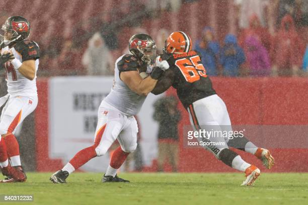 Tampa Bay Buccaneers offensive lineman Mike Liedtke blocks Cleveland Browns defensive lineman Larry Ogunjobi during an NFL preseason football game...