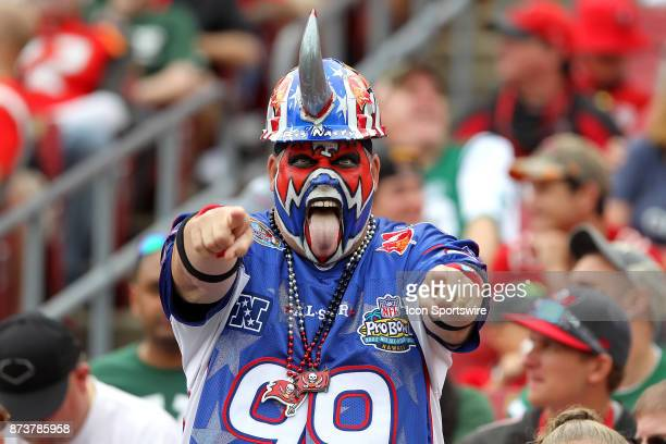 Tampa Bay Buccaneers Pro Football Hall of Fame fan Keith Kunzig aka 'Big Nasty' signals his support for the Bucs during the regular season game...