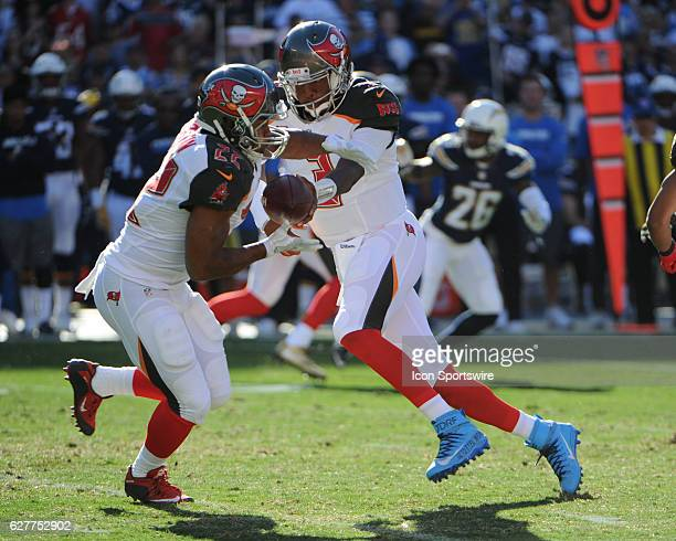 Tampa Bay Buccaneers Quarterback Jameis Winston hands off the ball to Tampa Bay Buccaneers Running Back Doug Martin during the NFL football game...
