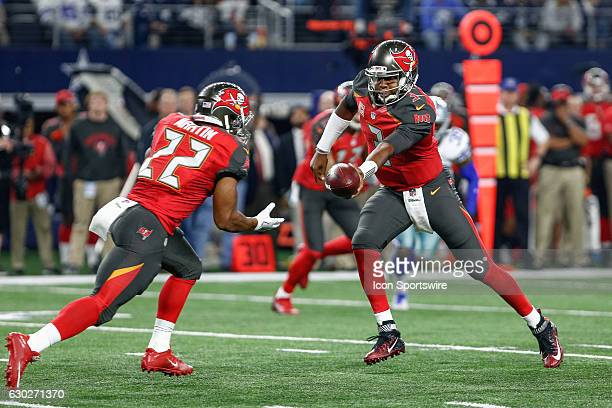 Tampa Bay Buccaneers Quarterback Jameis Winston hands the ball off to Running Back Doug Martin during the NFL Sunday night game between the Tampa Bay...