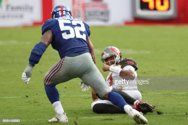 Tampa Bay Buccaneers quarterback Jameis Winston slides to avoid being hit by New York Giants outside linebacker Jonathan Casillas during the NFL game...