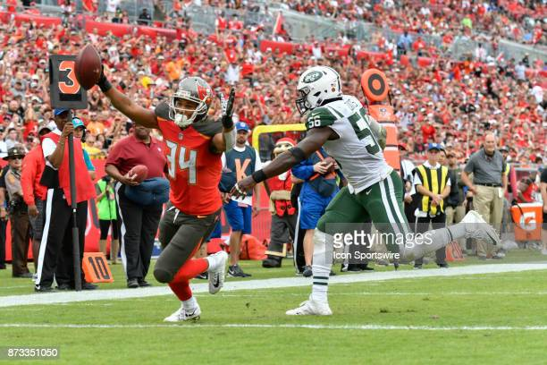 Tampa Bay Buccaneers running back Charles Sims III begins to celebrate his fourth quarter touchdown reception as he beats New York Jets linebacker...