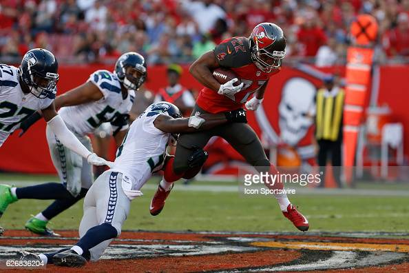 Tampa Bay Buccaneers running back Doug Martin attempts to run thru a tackle by Seattle Seahawks strong safety Kam Chancellor during the NFL game...
