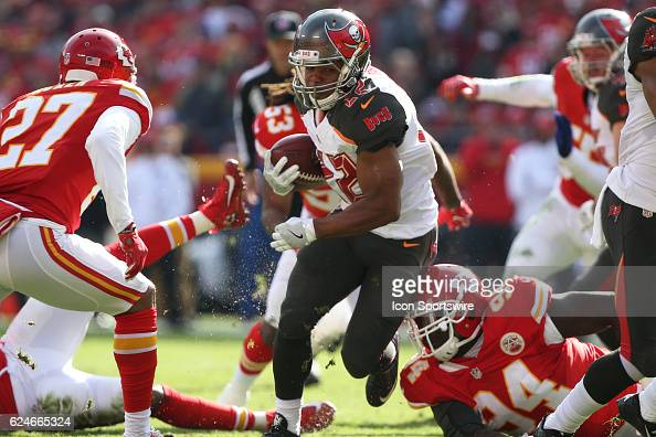 Tampa Bay Buccaneers running back Doug Martin gets through the hole in the first half of a week 11 NFL game between the Tampa Bay Buccaneers and the...