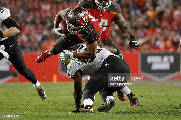 Tampa Bay Buccaneers running back Doug Martin is hit by New Orleans Saints outside linebacker Stephone Anthony as he runs with the ball during the...