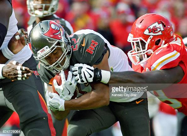 Tampa Bay Buccaneers running back Doug Martin is stopped by Kansas City Chiefs defensive tackle Rakeem NunezRoches in the first quarter on Sunday Nov...