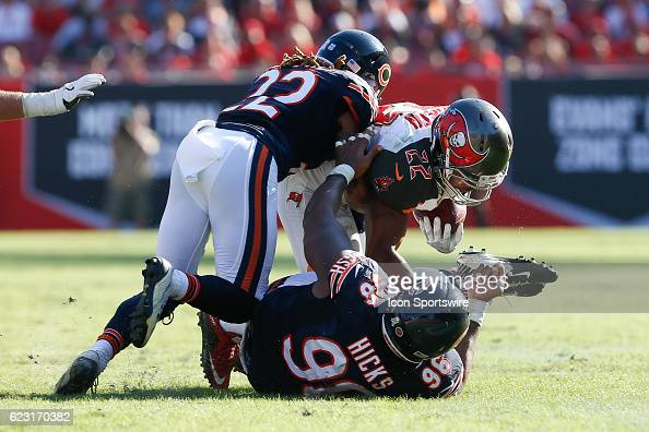 Tampa Bay Buccaneers running back Doug Martin is tackled by Chicago Bears defensive end Akiem Hicks and Chicago Bears cornerback Cre'von LeBlanc in...