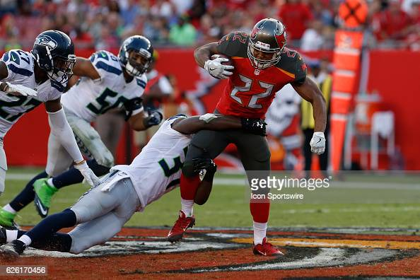 Tampa Bay Buccaneers running back Doug Martin is tackled by Seattle Seahawks strong safety Kam Chancellor in the 2nd quarter of the NFL game between...