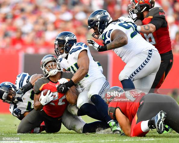Tampa Bay Buccaneers Running Back Doug Martin is tackled by Seattle Seahawks Linebacker Cassius Marsh during an NFL football game between the Seattle...