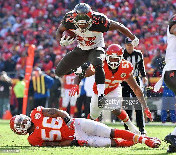 Tampa Bay Buccaneers running back Doug Martin leaps over Kansas City Chiefs inside linebacker Derrick Johnson in the second quarter on Sunday Nov 20...