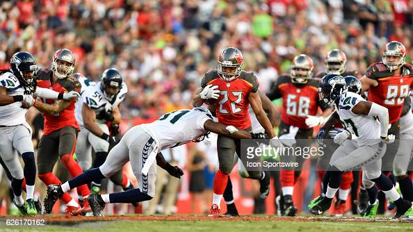 Tampa Bay Buccaneers Running Back Doug Martin looks to avoid a tackle during an NFL football game between the Seattle Seahawks and the Tampa Bay...