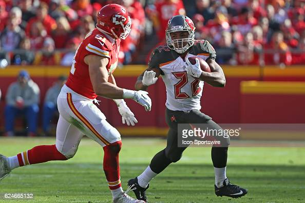 Tampa Bay Buccaneers running back Doug Martin looks to evade Kansas City Chiefs outside linebacker Frank Zombo during a week 11 NFL game between the...