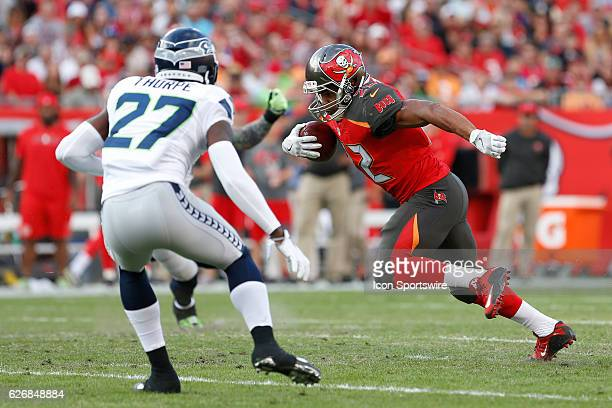 Tampa Bay Buccaneers running back Doug Martin run s the ball toward Seattle Seahawks defensive back Neiko Thorpe during the NFL game between the...