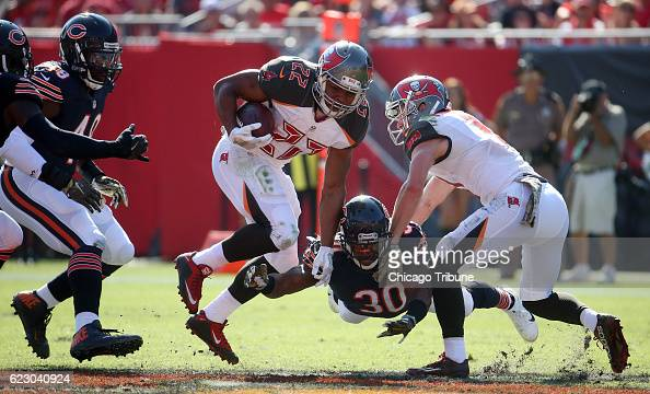 Tampa Bay Buccaneers running back Doug Martin runs against Chicago Bears cornerback Demontre Hurst in the second quarter on Sunday Nov 13 2016 at...