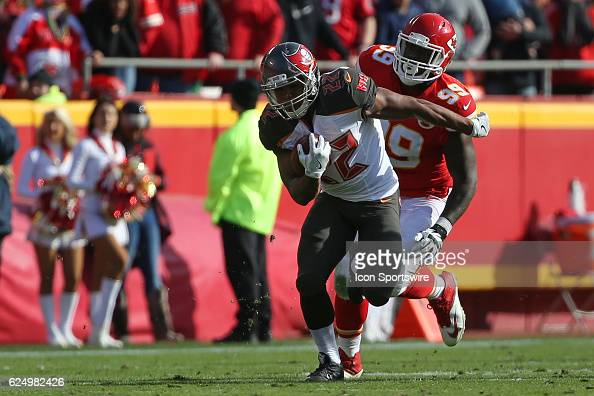 Tampa Bay Buccaneers running back Doug Martin runs past Kansas City Chiefs defensive tackle Rakeem NunezRoches during a week 11 NFL game between the...