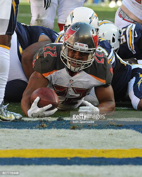 Tampa Bay Buccaneers Running Back Doug Martin squeezes through the Chargers line for a touchdown during the NFL football game between the Tampa Bay...