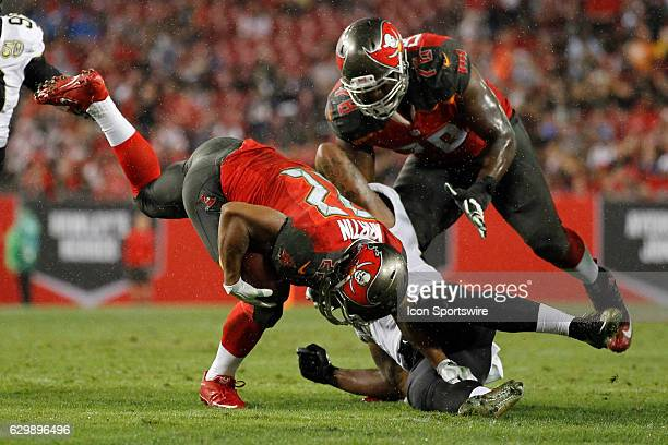 Tampa Bay Buccaneers running back Doug Martin stays on his feet after being hit by New Orleans Saints outside linebacker Stephone Anthony during the...