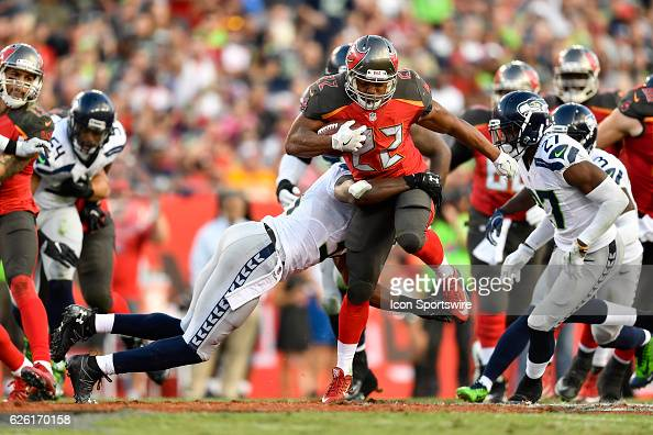 Tampa Bay Buccaneers Running Back Doug Martin tries to break a tackle during an NFL football game between the Seattle Seahawks and the Tampa Bay...