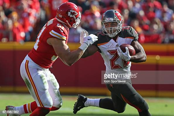 Tampa Bay Buccaneers running back Doug Martin tries to fend off Kansas City Chiefs outside linebacker Frank Zombo during a week 11 NFL game between...