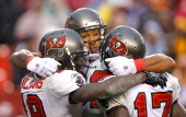 Tampa Bay Buccaneers tight end Kellen Winslow celebrates his touchdown with teammates Mike Williams and Arrelious Benn during the second half at...