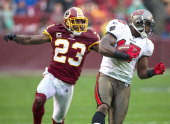 Tampa Bay Buccaneers wide receiver Arrelious Benn catches a pass for a long gain in front of Washington Redskins cornerback DeAngelo Hall during the...