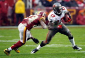 Tampa Bay Buccaneers wide receiver Arrelious Benn is hit by Washington Redskins cornerback DeAngelo Hall during the second half at FedEx Field in...