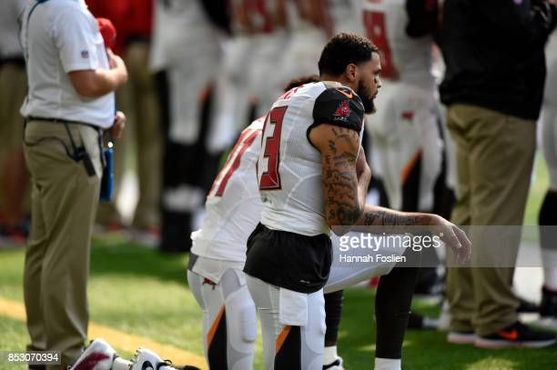 Tampa Bay Buccaneers Wide Receivers Mike Evans and DeSean Jackson take a knee during the national anthem before the game against the Minnesota...