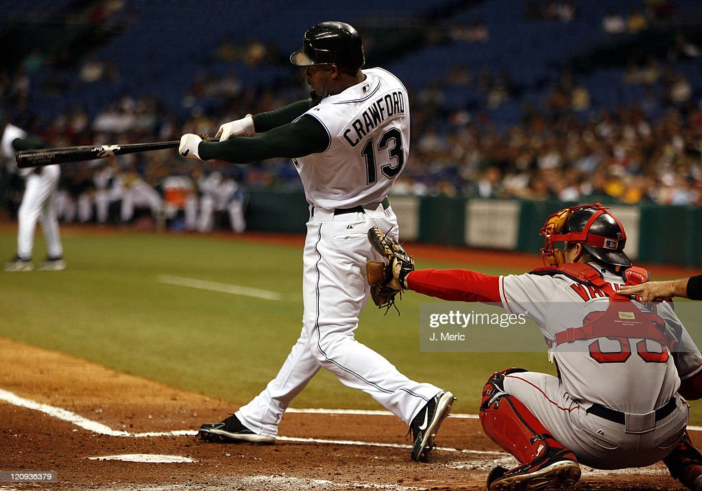 Tampa Bay Devil Rays' <a gi-track='captionPersonalityLinkClicked' href=/galleries/search?phrase=Carl+Crawford&family=editorial&specificpeople=208074 ng-click='$event.stopPropagation()'>Carl Crawford</a> takes a swing as Boston Red Sox' <a gi-track='captionPersonalityLinkClicked' href=/galleries/search?phrase=Jason+Varitek&family=editorial&specificpeople=171480 ng-click='$event.stopPropagation()'>Jason Varitek</a> receives the pitch during Wednesday night's game at Tropicana Field in St. Petersburg, Florida on July 5, 2006.